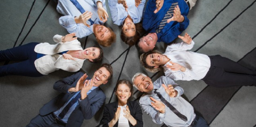 Business team lying on floor and clapping